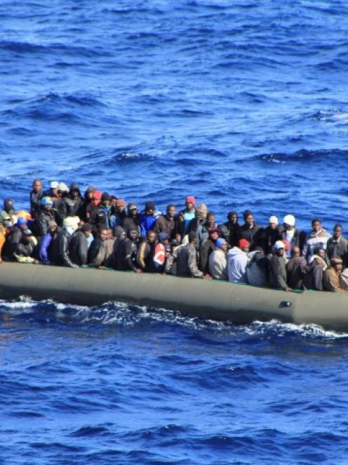 A boatload of migrants involved in the rescue operation. REUTERS/Marina Militare/Handout via Reuters