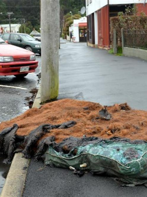 A burnt mattress lies in Howe St in Dunedin yesterday afternoon. Photo by Peter McIntosh.