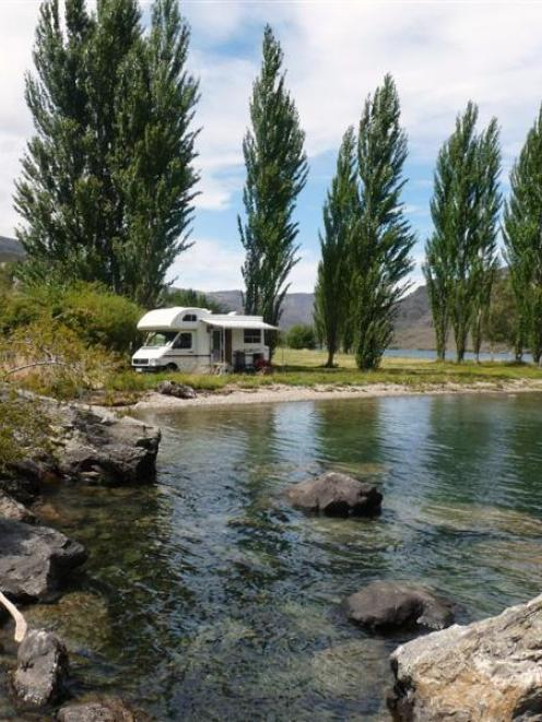 A camper van on the shore of Lake Dunstan. Photo supplied.
