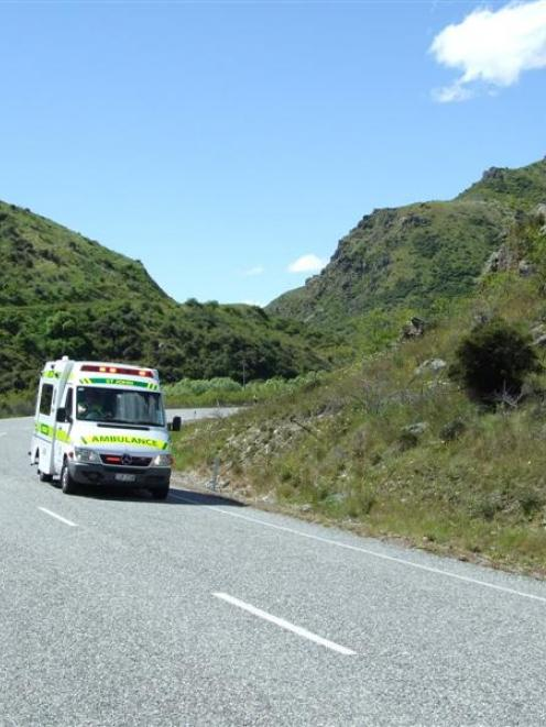The car driver being transported to hospital after the double-fatality crash in the Lindis Pass....