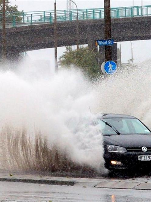 A car sprays pooled water at the intersection of Fryatt and Wharf Sts  in Dunedin yesterday....