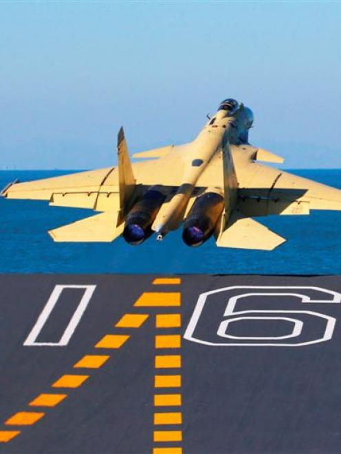 A carrier-borne J-15 fighter jet takes off from the Liaoning, China's first aircraft carrier....