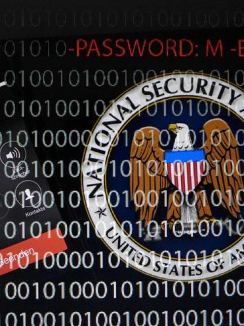 A computer with a series of numbers and the logo of the United States' National Security Agency ...