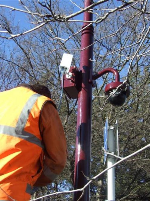 A contractor from Wellington company I-See installs one of 10  CCTV cameras in Queenstown last...