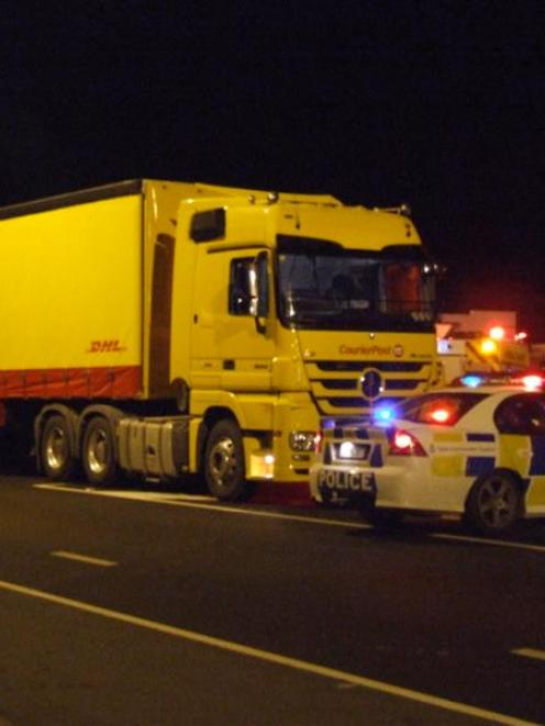 A CourierPost truck sits at the scene of a collision with two young women on Thames Highway on...