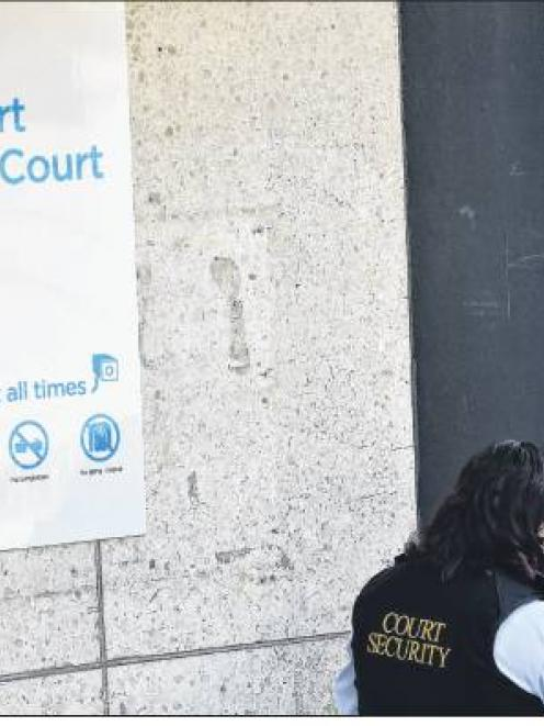 A court security officer talks on her phone after a teenager entered the building with a BB gun...