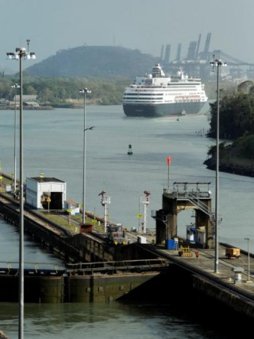 A cruise liner sails by the Miraflores lock of the Panama Canal in Panama City. REUTERS/Carlos Jasso