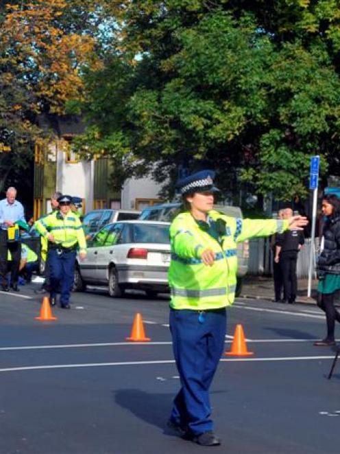 A Dunedin police officer directs traffic off Cumberland St where an elderly male pedestrian was...