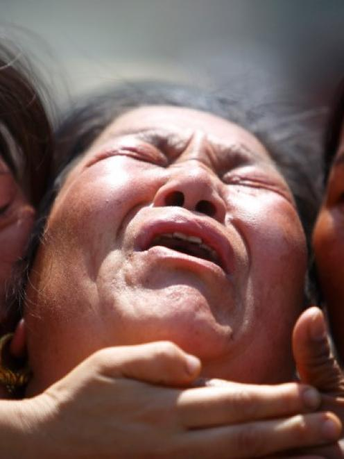 A family member a sherpa is comforted by her relatives during a funeral rally in Kathmandu for...