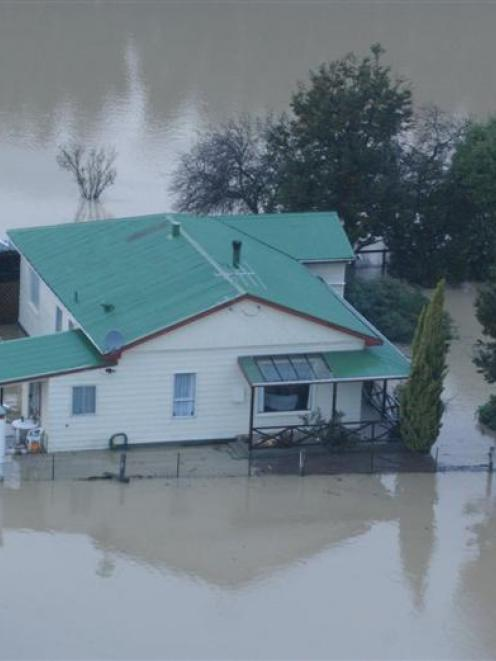 A flooded farmhouse on the Taieri in April 2006.  Photo by Peter McIntosh.