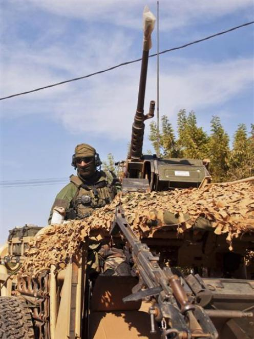 A French elite special operations soldier drives towards the Malian  capital  of Bamako to meet...