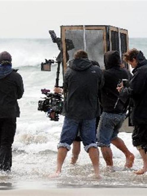 A German-led film crew films Elisabeth Lanz (far left), playing marine biologist Julia, for a...