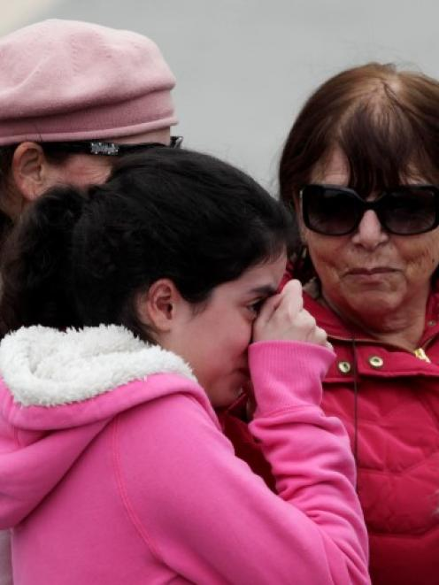 A girl cries as she stands in front of Ariel Sharon's coffin outside the Knesset in Jerusalem....