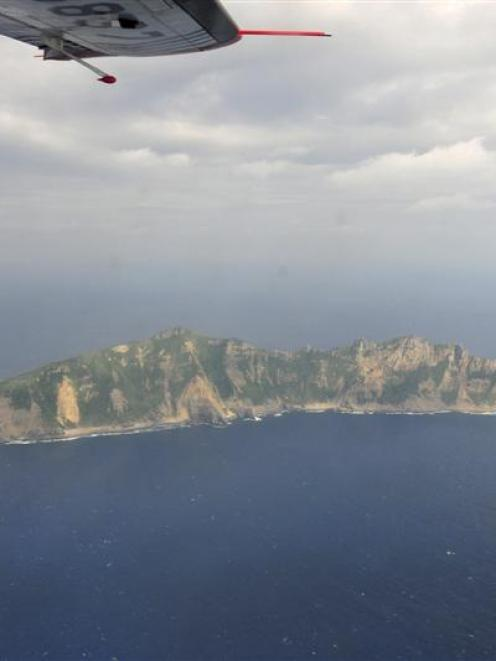 A handout photograph taken from a marine surveillance plane  shows one of the disputed islets,...