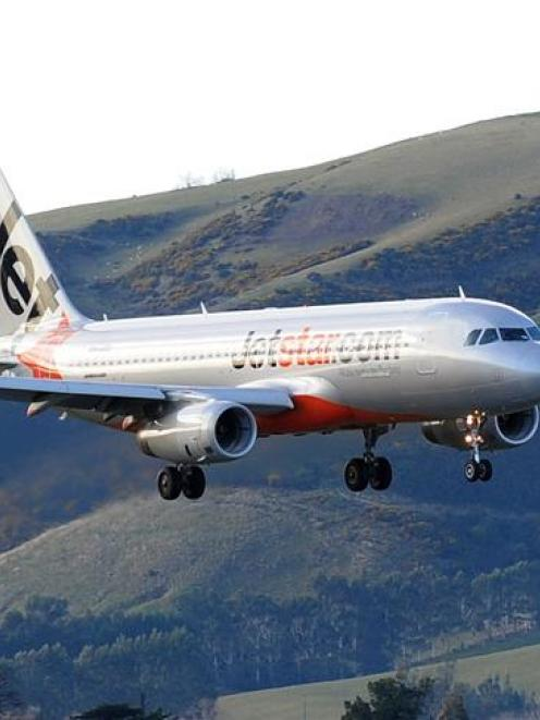 A Jetstar Airbus A320  flies into  Dunedin International Airport.  Net migration is at its...