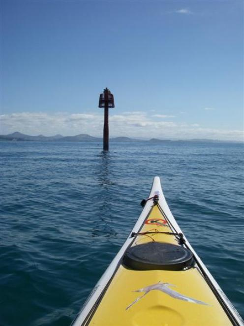 A kayaker coming out of the southern end of the Big Eddy, heads towards the approaches light...