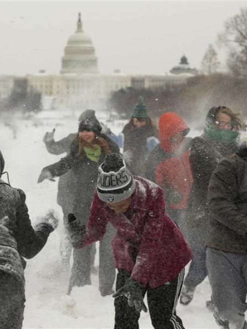 A large snowball fight breaks out on The Mall in Washington after a powerful winter storm hit the...