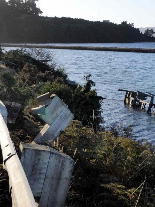 A logging truck lost its trailer which crashed through a barrier and into Blanket Bay early this...