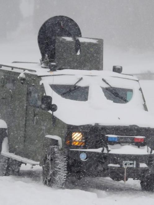 A Los Angeles county sheriff SWAT vehicle heads out in the heavy snow as the search continues for...