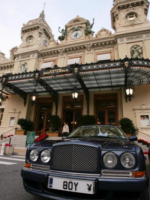 A luxury car is parked outside the Monaco casino in Monte Carlo, a playground for the world's...