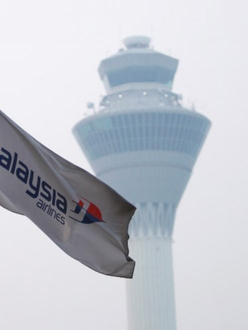 A Malaysia Airlines flag flies at Kuala Lumpur International Airport in Sepang. REUTERS/Samsul Said