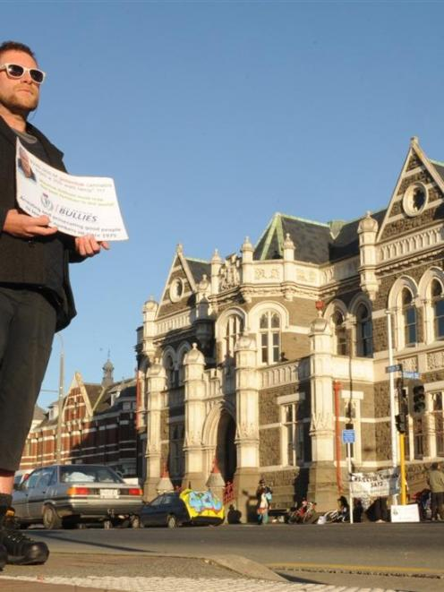 """A man calling himself """"Mr Grass"""" protests outside the Dunedin law courts building. Photos by..."""