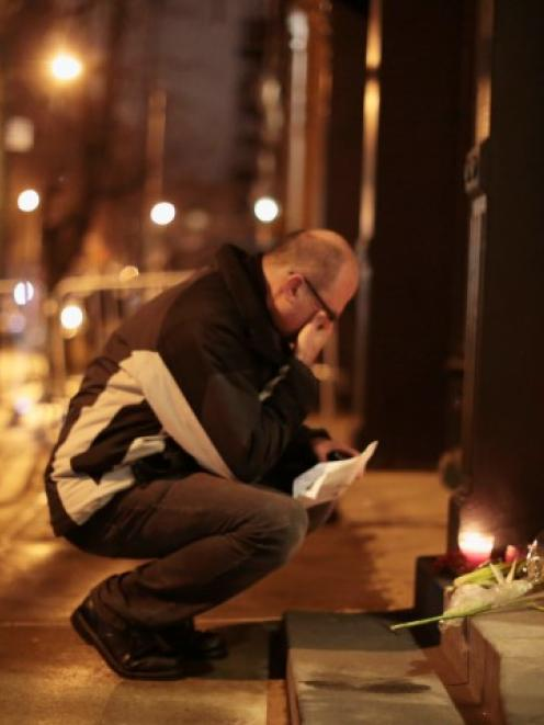 A man mourns outside the apartment where Philip Seymour Hoffman was found dead in Manhattan, New...