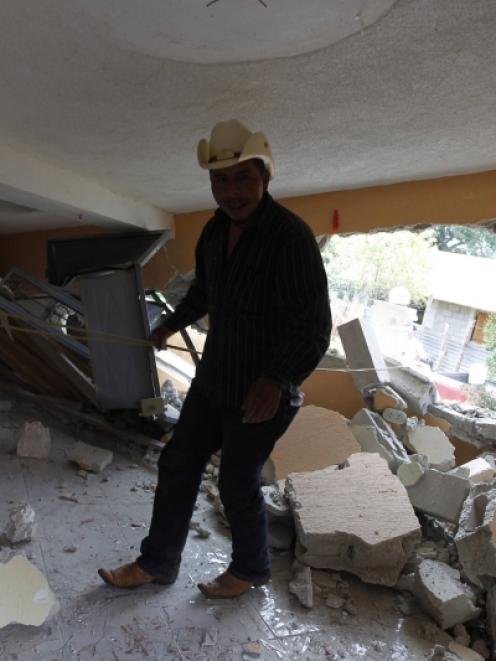 A man stands in an earthquake-damaged house in the San Marcos region, in the northwest of...