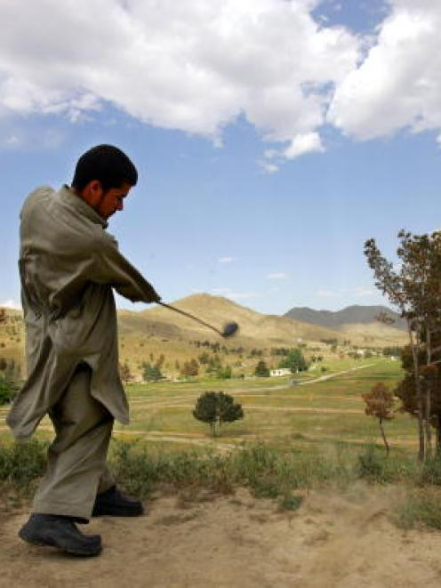 A man tees off on the second hole at the Kabul Golf Club. Photo Getty Images