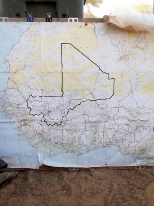 A map of Mali is seen at the French military base camp at Timbuktu's airport. REUTERS/Benoit Tessier