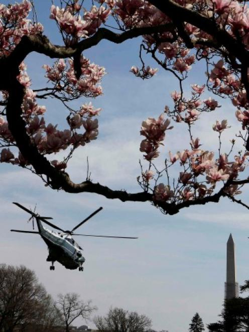 A Marine One helicopter carries US President Barack Obama away from the White House in Washington...