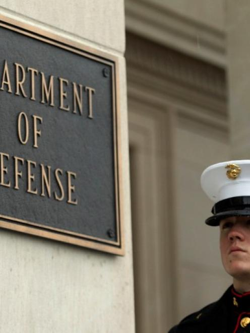 A marine stands guard outside the Pentagon in Washington. Photo Reuters