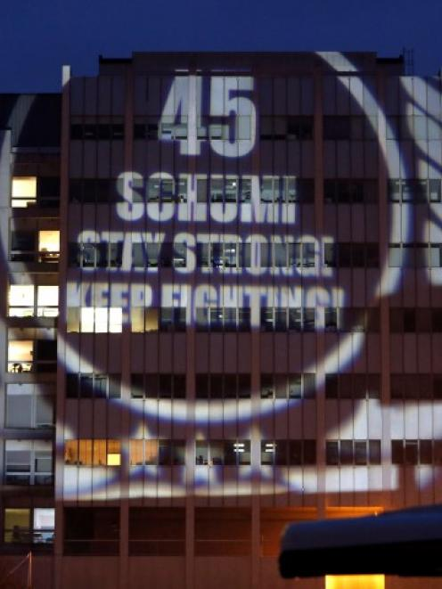 A message to mark Michael Schumacher's 45th birthday is projected by fans on the facade of the...