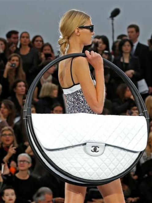A model presents a creation by German designer Karl Lagerfeld for French fashion house Chanel. ...