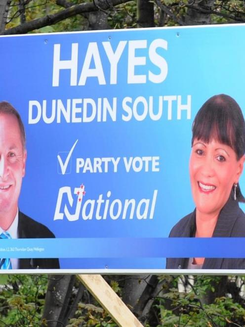 A National candidate's hoarding shared with the Prime Minister and a Labour candidate on his own.