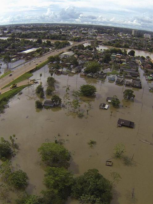 A neighbourhood flooded by the Acre river after weeks of heavy rainfall in northern Bolivia and...