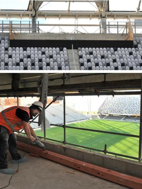 A new media box takes shape at the the top of  Forsyth Barr Stadium's north stand, while (below)...
