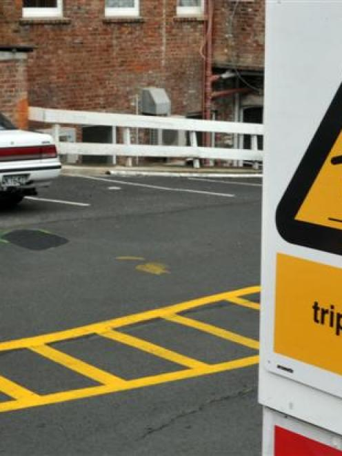 A new trip hazard warning sign and repaired pothole in Dowling St car park yesterday. Photo by...