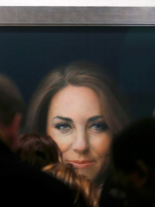 A newly commissioned official painting of Catherine, Duchess of Cambridge is seen at the National...