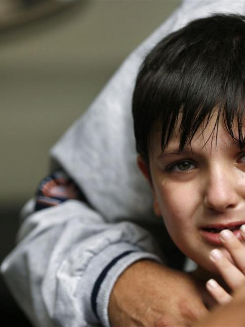 A Palestinian boy cries after what witnesses said was an Israeli air strike in Gaza City. A truce...