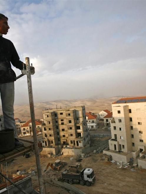 A Palestinian labourer is seen at a construction site in the West Bank Jewish settlement of Maale...