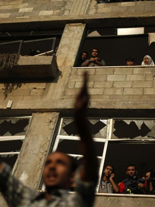 A Palestinian man reacts at the scene of an Israeli air strike on a house in Gaza City.  REUTERS...