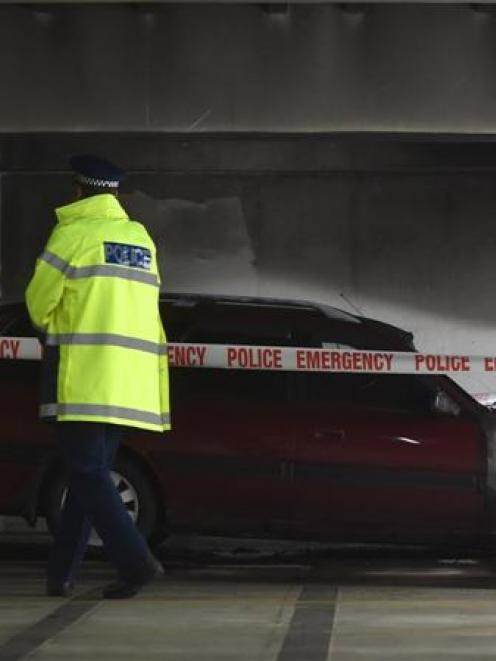 A police officer at the scene of Saturday's car fire at Wilson  Park building in Moray Pl. Photo...