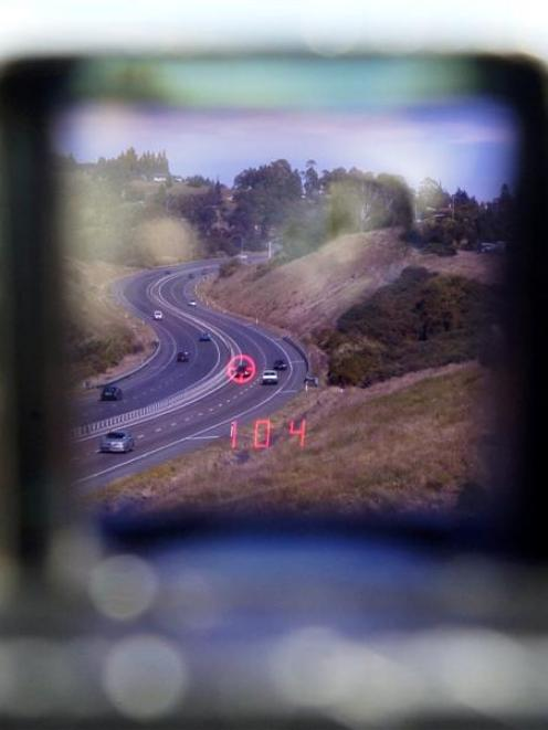 A police speed laser scans traffic on Dunedin's Southern Motorway near Fairfield yesterday. Photo...
