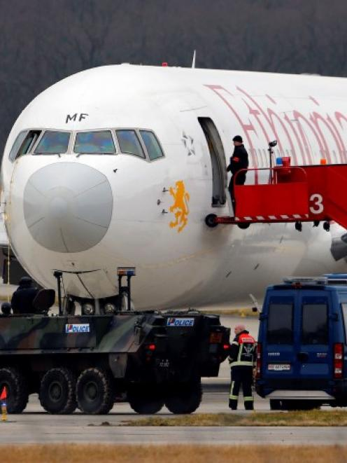 A police vehicle is stationed in front of the hijacked Ethiopian Airlines flight ET 702 after...
