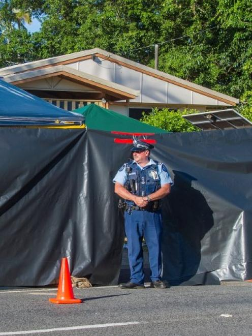 A policeman guards the scene of the tragedy in Cairns. REUTERS/Stringer