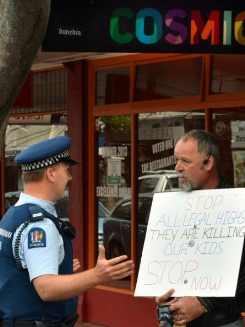 A policeman talks to Calvin Hooper about his protest in Dunedin yesterday against synthetic...