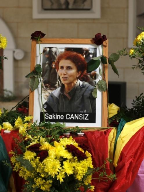 A portait of late PKK activist Sakine Cansiz is seen at the Kurdish cultural centre in Paris,...
