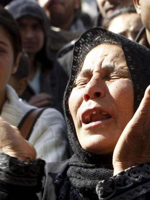 A relative of a man who died in clashes between police and demonstrators mourns during his...