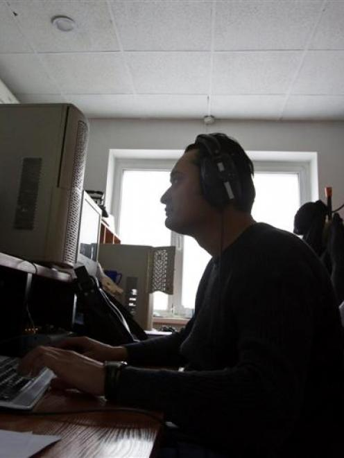 A reporter works in an editing room of Stan.TV Internet portal in Almaty. The Central Asian state...